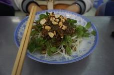 Gỏi đu đủ bò khô- Papaya salad topped with beef jerky